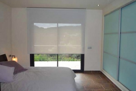 One of the 3 bright bedrooms