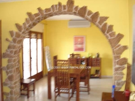 View into dining room through typical arch
